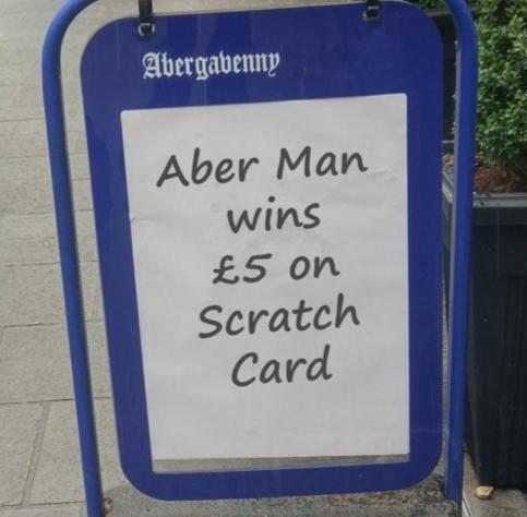 newspaper aboard stating Aber man wins £5 on scratch card