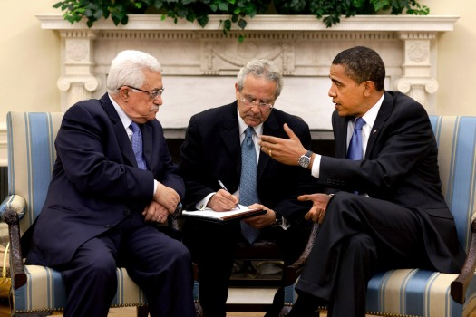 image of President Barack Obama meets with Palestinian Authority President Mahmoud Abbas in the Oval Office Thursday, May 28, 2009.  The man sitting between them is an interpreter.