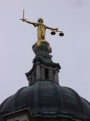 image of gilded statue of Justice on top of Old Bailey