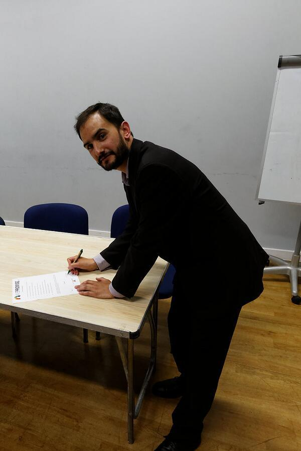 Green European Parliament candidate Audaye Elesedy signs the Charter of Digital Rights at St Werburgh's Community Centre