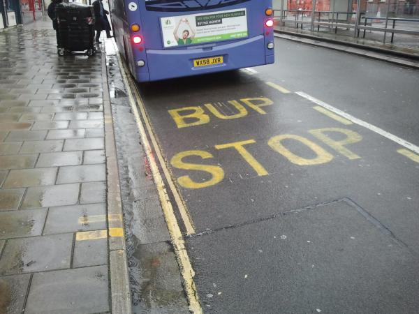 image of bus stop featuring words Bup Stop