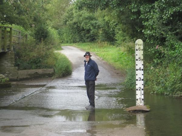 image of author standing in Quinny Brook ford