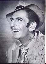 Arthur English in character as a spiv