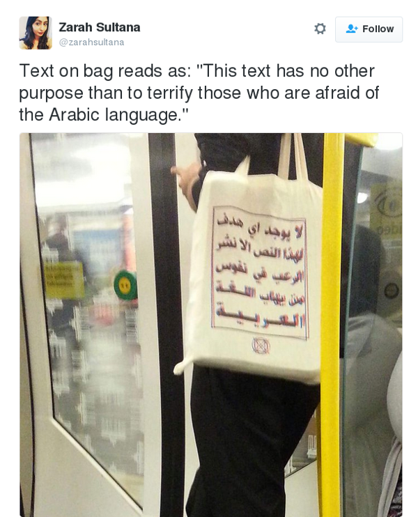 tweet text reads text on bag reads as follows - this text has no other purpose than to terrify those who are afraid of the Arabic language